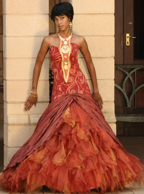 Traditonal African Wedding Dresses | God's Grace Weddings. SR I like this print. Maybe minus and the make minus the large frill at the bottom. Think less could be better. Print can go further down then flow out into a slight train. :-)
