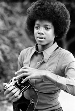 Michael Jackson using a Praktica (?)