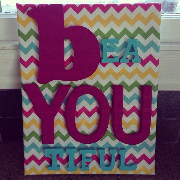 Inspiration sigh for kids! Cheap canvas covered in fabric with wood letters hot glued on.