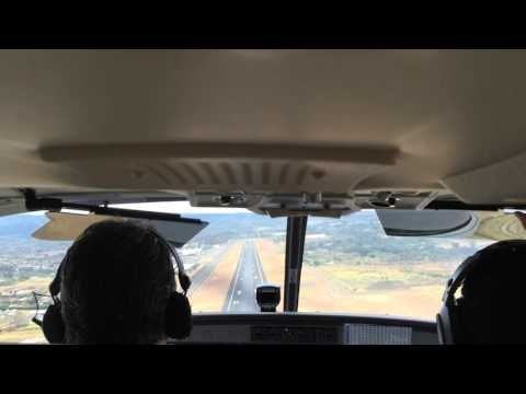 """This is a cockpit view of our landing at Juan Santamaría International Airport (SJO), San Josè, Costa Rica, via Sansa Airlines. This airplane is a """"Cessna 208 Caravan"""", that typically seats nine passengers with a single pilot. Its single-engine turboprop makes for an """"eTicket"""" ride! Our real flight adventure, however, was landing with this plane at the Drake Bay Airport (DRK), Punterenas, Costa Rica. Anybody who has landed at this """"airport"""" knows what I mean by, REAL ADVENTURE!"""