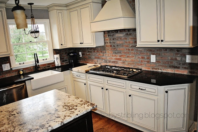 Brick backsplash island apron sink light above sink for Kitchen units made of bricks