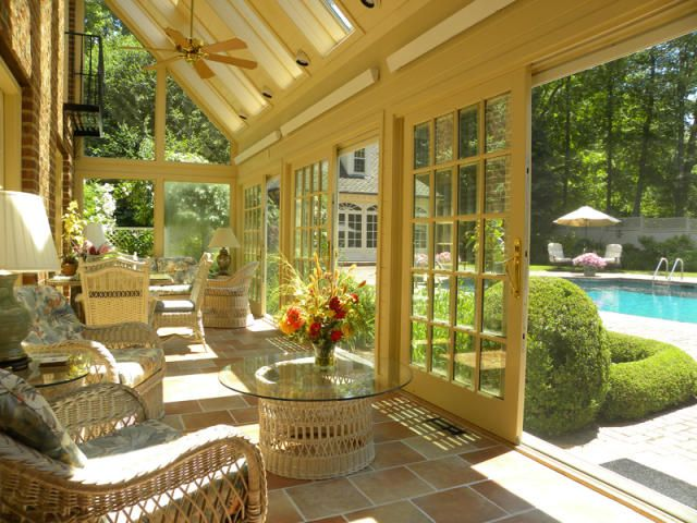 Sunroom...love the sliding doors instead of a swing door