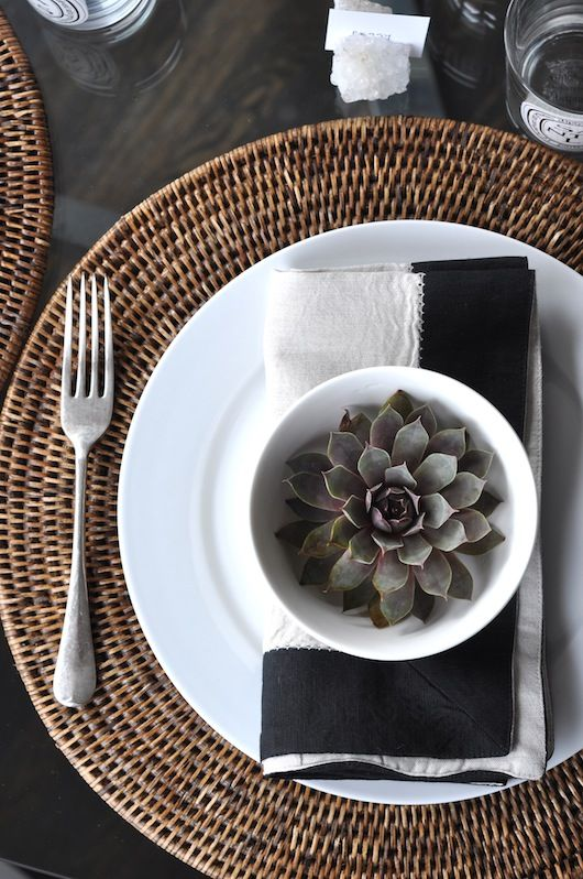 round wicker placemats, wicker napkins, succelents, black linen napkins, place settings, table settings | Burgess In House