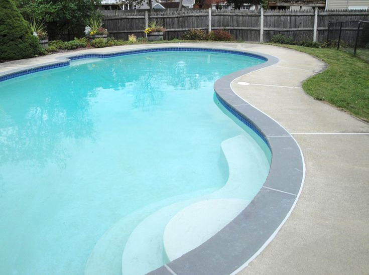 Finished pool with bluestone coping that was templated cut and set using a bonding agent tile for Best thinset for swimming pool tile