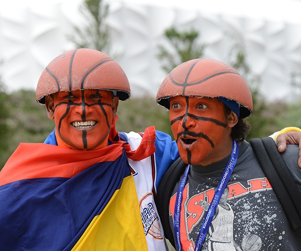 Spectators wearing hats made with a basketball arrive to watch the men's basketball preliminary round match Spain vs Brazil as part of the London 2012 Olympic Games. (Mark Ralston/AFP/Getty Images)