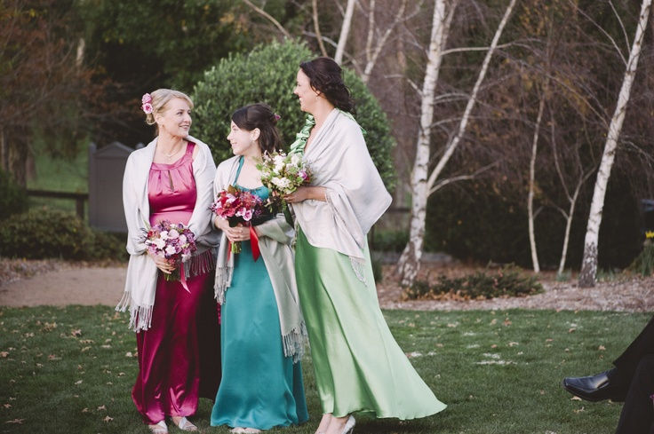 Beautiful Bright Bridesmaids.  Continuity was achieved by having all dresses the same length and in a jewel tone.  Also the bouquets were designed to match each bridesmaid.
