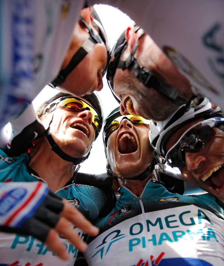 Omega Pharma-Quick Step procycling team rider Mark Cavendish of Britain (foreground right) celebrates with his teammates after winning the 5th stage of the 100th edition of the Tour de France.