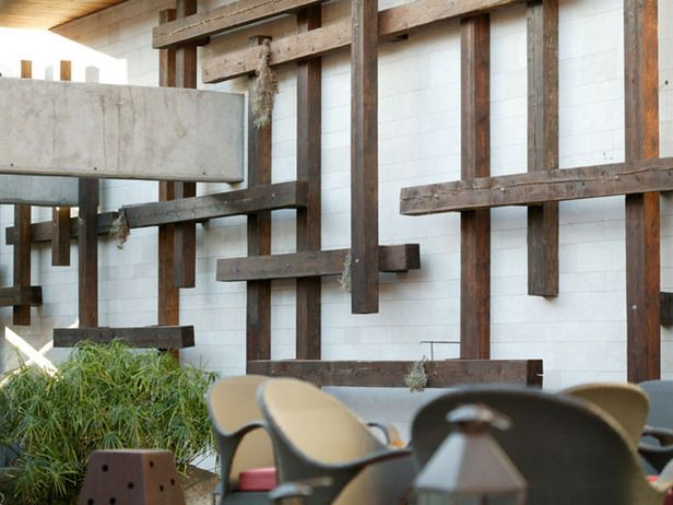 This wooden sculpture, designed by landscape artist Jamie Durie, functions as both an eye-pleaser and atering system. A misting system is installed within the recycled wood beams watering surrounding plants.