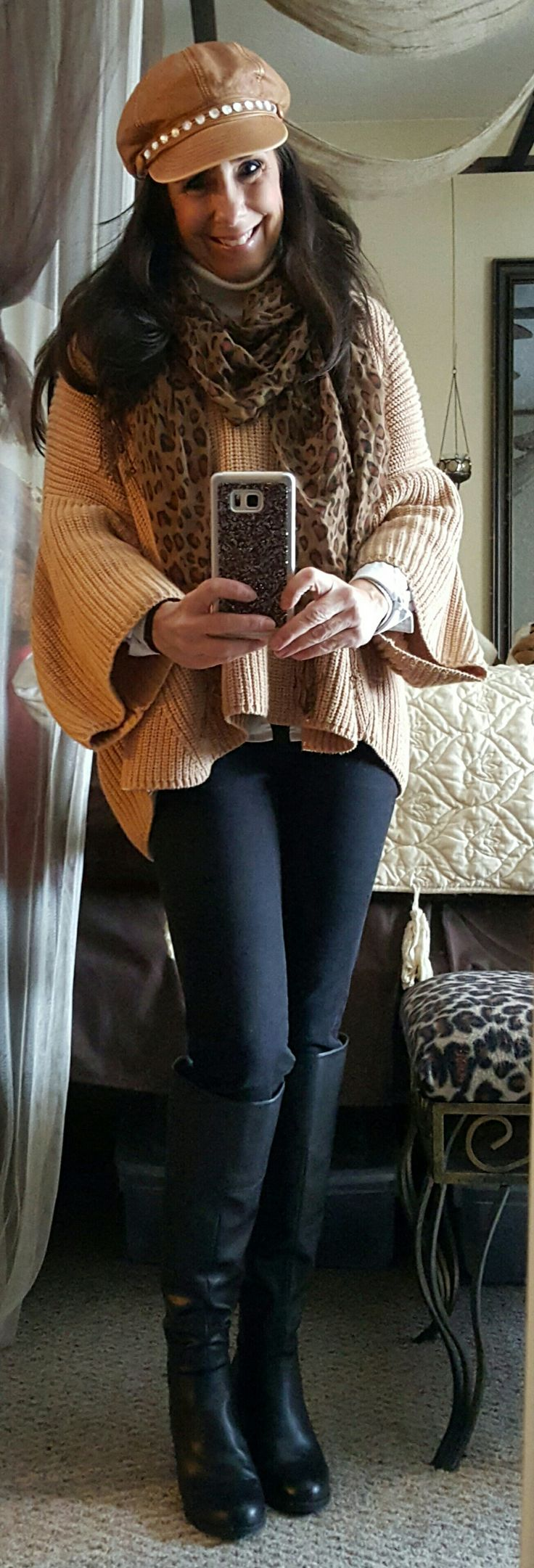 Black jeans tan sweater  boots  hat