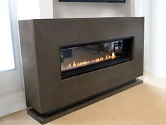 10' concrete fireplace surround with a Spark gas fireplace. Concrete Fireplace Surrounds -Trueform Concrete Custom Work