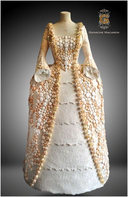 A life size wedding dress ala Marie Antoinette,  embelished entirely with delicate french macarons and hand made sugar paste roses. This Delectible creation was made by Audrey, owner of the famous London based Ganache Macarons.