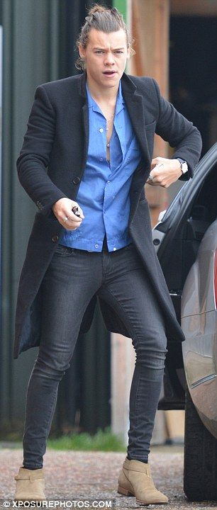 Slick: For the excursion, Harry wore a black coat over a blue button-down shirt and a pair...
