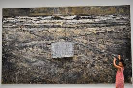 Image from http://washingtondc.picturesofus.net/Museums/Hirshhorn%20Museum/Aiesha%20in%20Front%20of%20The%20Book%20by%20Anselm%20Kiefer.JPG.