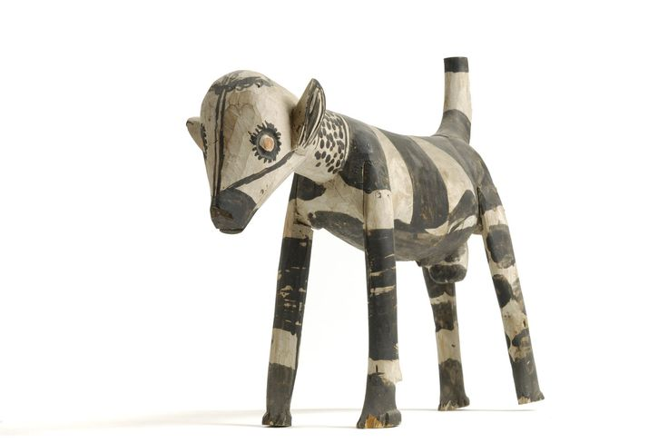 Black and white striped dog carving from Nigeria which dates from 1900 - 1917. Charles Partridge Collection, World Collection, Ipswich.