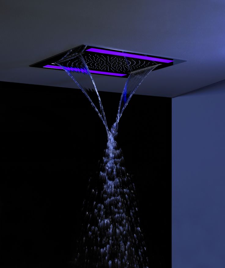 A waterproof remote control feature offering a choice of seven colours and colour rotation - Rio Revive Showerhead with Purple LED Lighting from Crosswater. http://www.crosswater.co.uk/product/rio-revive/rio-revive-fixed-heads/