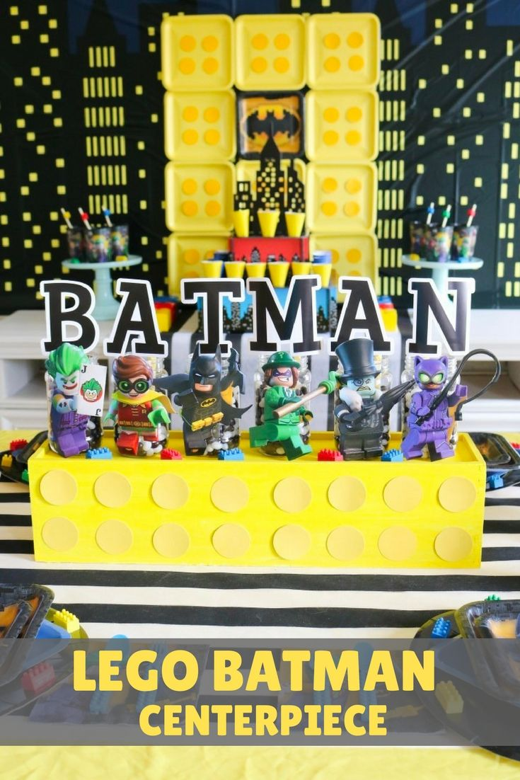 What's cooler than a giant LEGO® topped with delicious candies and oversized Batman heroes and villains?! @sweetlychicdes dreamed up this ultra colorful Batman centerpiece to complement a LEGO Batman Party. Celebrate the release of The Lego Batman Movie with your little superheroes by creating this larger than life LEGO centerpiece at home with a few supplies, yummy sweets and some character details!