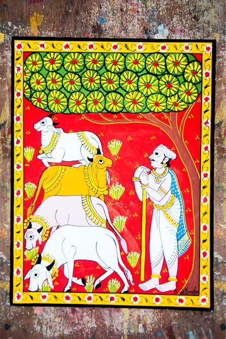 Scroll showing a person letting its cows graze in field.