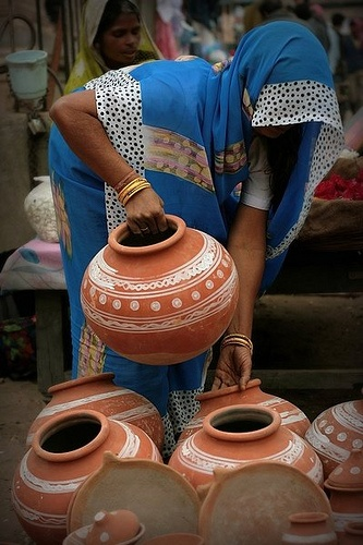 Pot seller in India. Water from this is cold and thirst quenching.