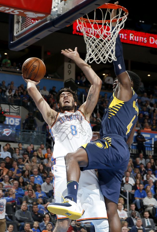 Oklahoma City's Alex Abrines (8) goes to the basket beside Indiana's Victor Oladipo (4) during an NBA basketball game between the Oklahoma City Thunder and the Indiana Pacers at Chesapeake Energy Arena in Oklahoma City, Wednesday, Oct. 25, 2017.  Photo by Bryan Terry, The Oklahoman