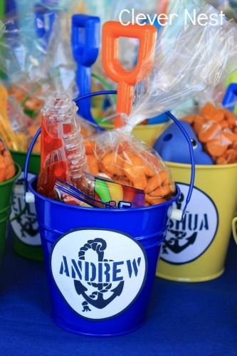 Pail and shovel party favors. Clever Nest: Vintage Nautical First Birthday, beach, ocean, summer, navy blue, orange, yellow, party