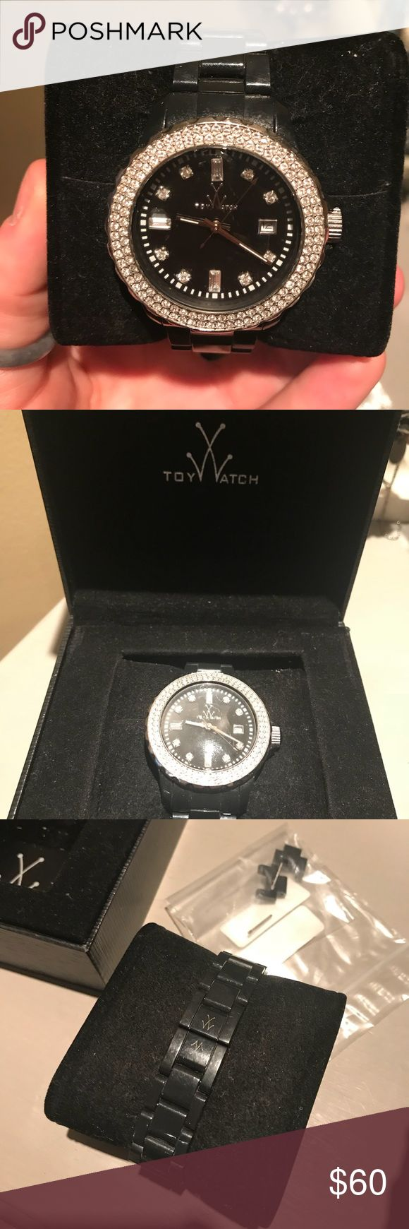 Toy Watch Black toy Watch. Have only worn it maybe 5 times! Am moving and getting rid of a lot of items. Has the extra links Incase you need more room. ToyWatch Jewelry