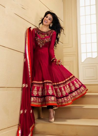 This deep magenta pure georgette anarkali suit is beautifully designed with embroidery, heavy border, hand work and border patch work. Matching bottom and dupatta comes along with this to add the glam. Accessories shown in this image is just for photography purpose. Slight variation in color and border patch is possible. This suit can be stitched easily from 32 to 44 inch Bust Size. www.indiantrendz.com