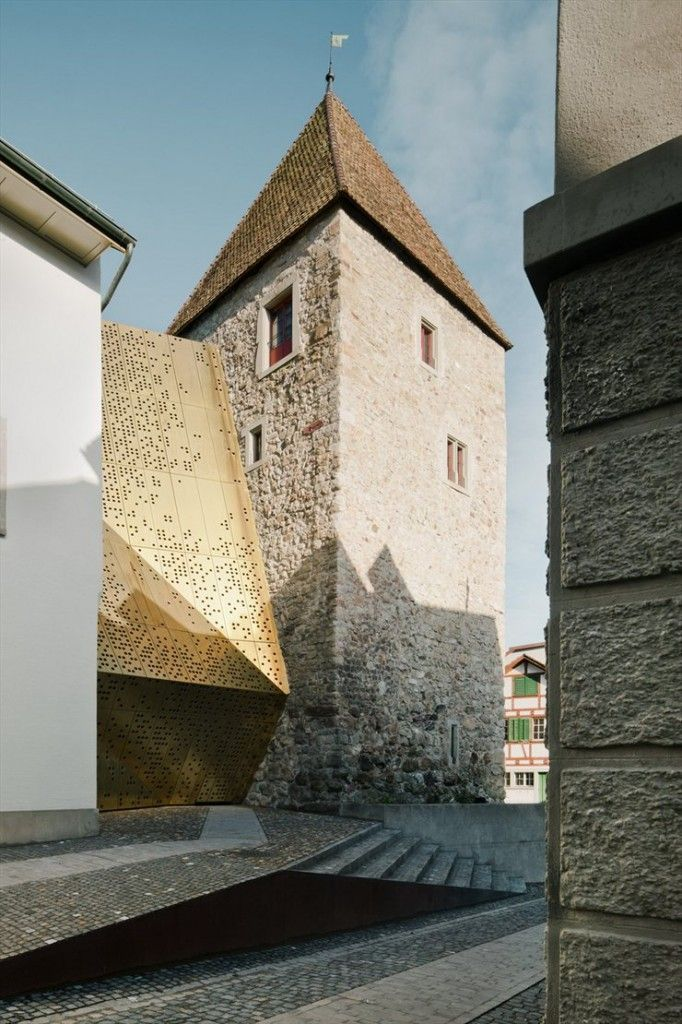 Rapperswil-Jona Municipal Museum designed by the architects at :mlzd. The structure sits on the banks of Lake Zurich and boasts a history of over 700 years