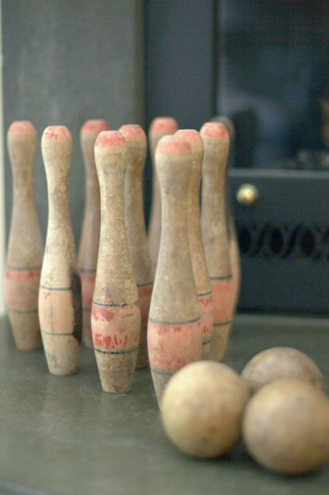 Old (lawn bowling ?) pins. Love the faded to pink color.