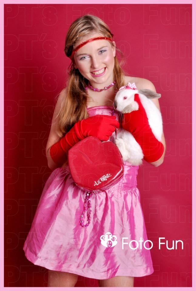 Very pink teenage girl and rabbit