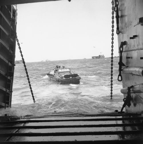 A DUKW, loaded with tank and SP gun ammunition, leaving a landing ship off the Normandy coast/6 June 1944