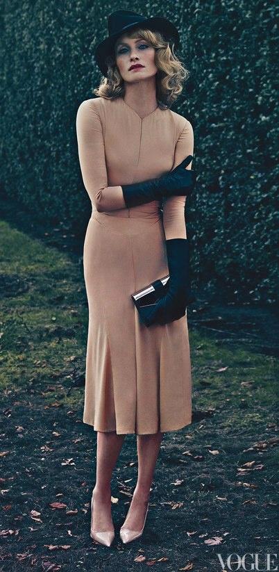 Vogue January 2012, Amber Valletta: Calvin Klein Collection silk-crepe dress. LaCrasia gloves. Ralph Lauren Collection clutch.