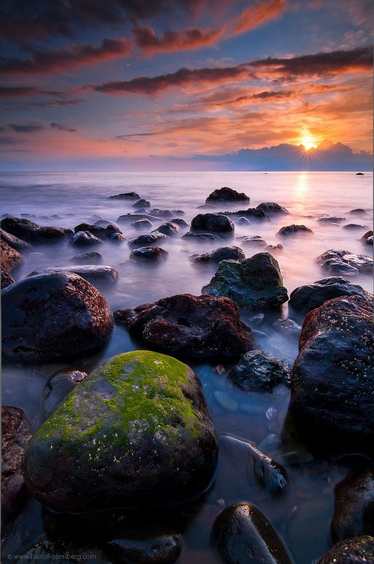 A colourful sunset at Playa san Juan in Tenerife south. In the horizon is the island of la Gomera where colombus made his last stop before heading off to find the new world. LEE filters