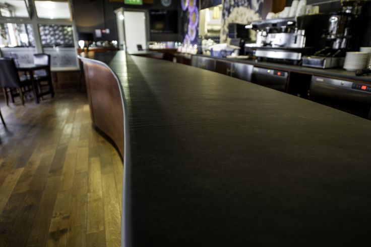 Full Length View Of A Contemporary And Modern Bar Worktop That Has A Long  Slate Work