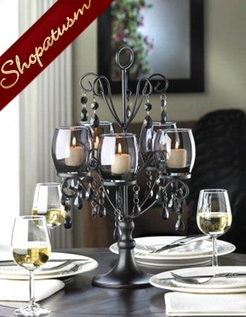 The Midnight Elegance Candelabra is the perfect centerpiece for a romantic  table setting, combining the shadowy glow of five