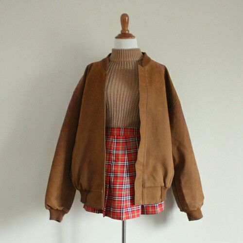 Brown suede jacket, tan ribbed turtleneck, red plaid mini skirt