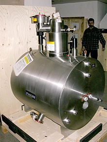 7 T horizontal bore superconducting magnet, part of a mass spectrometer. The magnet itself is inside the cylindrical cryostat. Superconducting magnet - Wikipedia