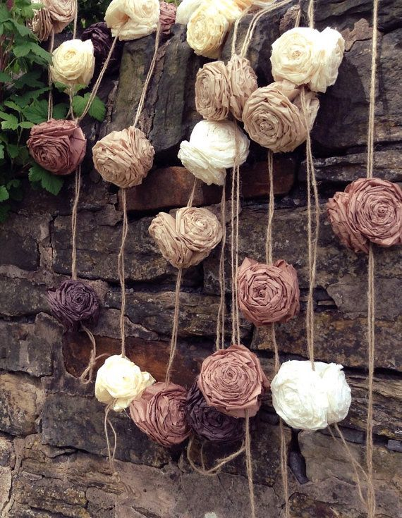 This listing is for a 4 metre handmade tissue rose garland. The photos show a set of 3 (4-metre) garlands in rustic coloured roses (Brown, Mocha, Khaki, French Vanilla & Ivory) put randomly on a stone wall. If you have a different colour scheme, please write this in the notes to seller box when checking out. If theres no message left, youll be be sent with the same colours as shown in the photos.