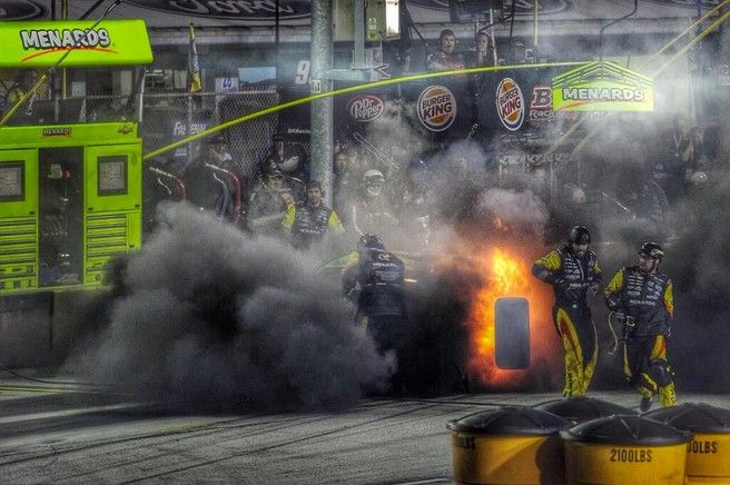 Paul Menard's right rear tire explodes in the pit area during the NASCAR Sprint Cup race @Barbara Acosta Snyder Miami - Amazing no one was hurt! From Twitter