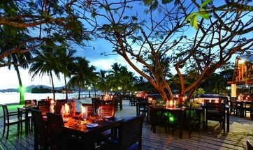 Outdoor dinning by candle light. Musket Cove Island Resort, Fiji