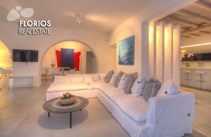 Luxury at its best! The spacious living room with dining area and a fully equipped kitchen. FL1174 Villa for Sale on Mykonos island Greece. http://www.florios.gr/en/Villas-For-Sale-Mykonos-Island-Greece.html