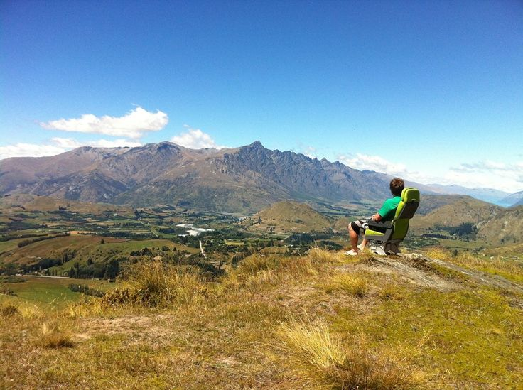 Sitting atop a mountain in an airline seat is not normal but this view is in Queenstown, New Zealand.