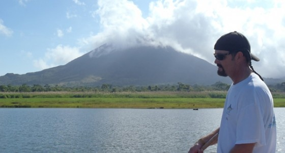 Fishing in Lake Arenal with the volcano in the background