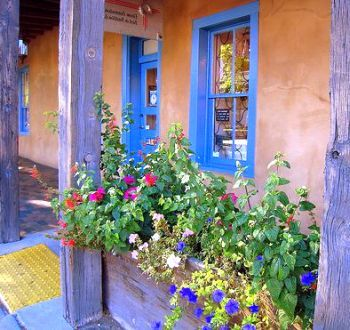 Southwestern style gardens, also referred to as Santa Fe style, are very natural and reflect the arid, sunny climate of the southwest.    Similar to xeriscape landscape design, southwest designs feature native plants.    Native plants can be colorful and vibrant, perfect for lively outdoor living spaces that require very little water or maintenance to thrive.