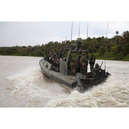 A Navy riverine patrol boat conducts amphibious assault exercise in Turbo Colombia Canvas Art - Stocktrek Images (35 x 23)