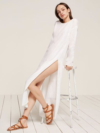 When it's hot and you want something not clingy - also looks great over a swimsuit. This is a loose fitting dress with high slits, a crew neckline and long sleeves.