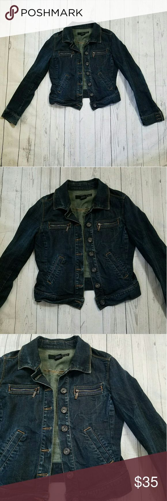 Calvin Klein Trucker Jacket Dark wash, button down. 2 slit pockets at was it, 2 zipper pockets on chest. Tight fit. 19 inches armpit to armpit. 16 inches across the waist. 19.5 inches long. 98% cotton, 2% elastane. Factory whiskering, faded elbows. Calvin Klein Jackets & Coats Jean Jackets