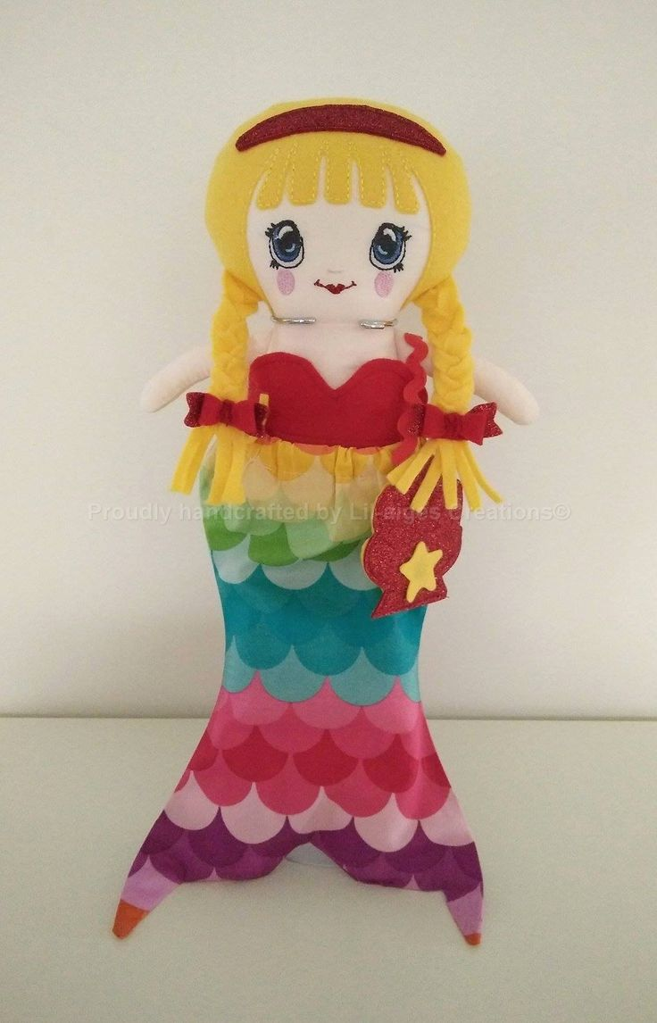 Awesome school girl rag doll design with mermaid tail dress up.  Entire creation created by:  Lil-aiges Creations.  Doll and Clothing Patterns by:  www.dollsanddaydreams.com