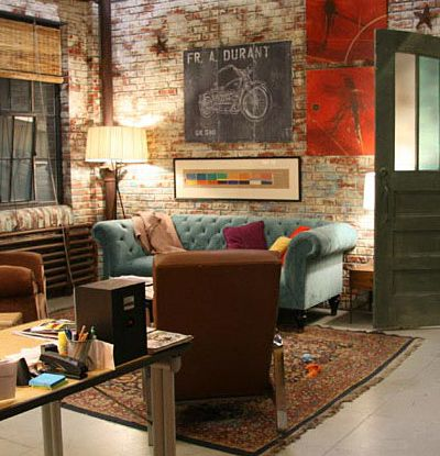 Great colours  industrial loft space. love the brick walls and the sofa