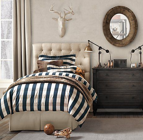 Greer big boy room plaid bedding | upholstered headboard | resin deer mount | love this for a little boy