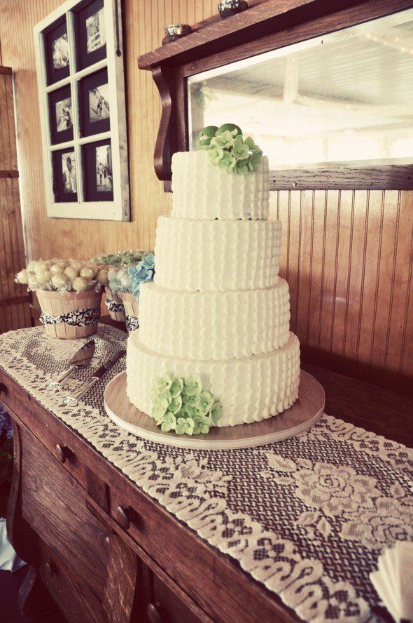 beautiful green and white wedding cake with two peas on a pod on top